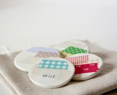 Funny buttons with masking tape! see them at www.melkstore.com