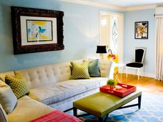 Top designers share their favorite shades for creating daring and unexpected living room color palettes that embrace bright colors and unique combinations.