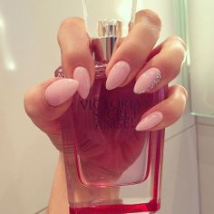 nude almond/stiletto nails
