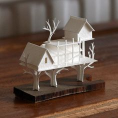 Hand made paper model, tree-house, on a wooden base. Completely drawn, cut and assembled by hand from acid-free watercolour paper.    Base size; 61 x