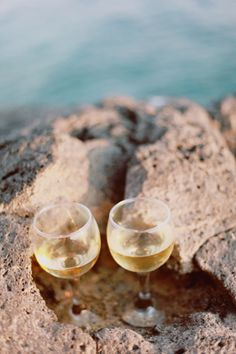 A pair of cold white wine glasses while you enjoy Potrerillos lake overview #Mendoza by @RutaMendoza #WineMoments