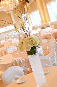 Hydrangea, curly willow & orchid centerpiece