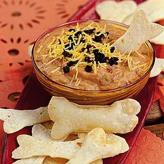 Goblin Dip with Bone Crackers Turn Tex-Mex bean dip into a Halloween specialty by serving it with bone-shaped crackers. Halloween Finger Foods, Halloween Fruit, Halloween Party Appetizers, Halloween Punch, Halloween Food For Party, Halloween Cupcakes, Easy Halloween, Halloween Treats, Halloween Dinner
