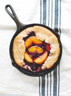 A simple and rustic dessert, with sweet summer fruit filling and folded pie crust edges.