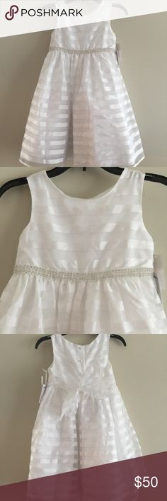 New Marmellata striped white flower girl dress 6X Beautiful girls white striped flower girl dress.  Rhinestone belting detail Ties in a bow in the back Buttons in back Color: white 100% polyester Size: Girls 6X Condition: New with tags!   Retails $94   Comes from a smoke free home.  Stock #: AR8-440 marmellata Dresses Formal