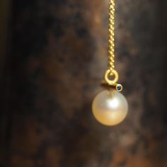 18ct yellow gold, an Australian south sea pearl from Cygnet Bay and two Australian blue sapphires courtesy of Marina Antoniou for Rare Earth: Australian Made. http://courtesyoftheartist.com.au