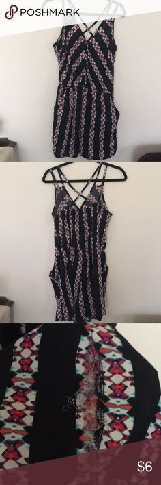 Cute romper Great romper for those hot sunny days, black, pink, red and white multi colored with cute criss cross backing. It does have a rip on the right side of the leg, it is an easy fix. Xhilaration Other