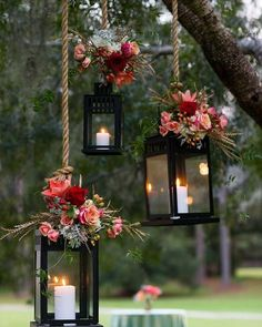 These beautiful #lanterns topped with flowers are #perfect for a garden theme wedding!