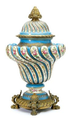 A MONUMENTAL SEVRES PORCELAIN, AND ORMOLU MOUNTED LOUIS XV STYLE URN SHAPED COVERED VASE, 19TH CENTURY
