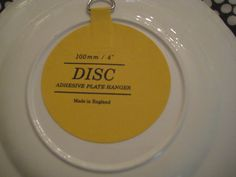 hang plates on wall with these discs instead of the wire hangers.