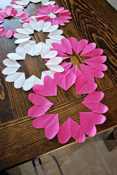 ok, hearts here, but wouldn't tissue paper snowflakes make a nice runner too? or springtime flowers, or leaves in fall colors...