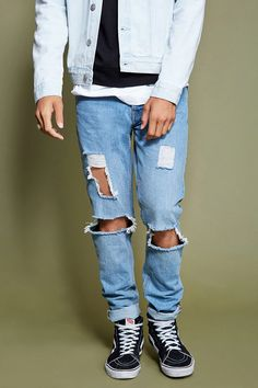 Style Deals - A pair of slim-fit jeans with distressed detailing, a five-pocket construction, and a concealed buttoned fly.