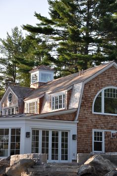 love the shake shingles windows . Love the Dutch Colonial roof . Looks so much like house I grew up in . I love the porch . We had that porch with those windows . They wrapped around the back of house. Shingle Style Architecture, Shingle Style Homes, Gambrel Roof, Dream Beach Houses, Dutch Colonial, Coastal Homes, Maine House, My Dream Home, Dream Homes