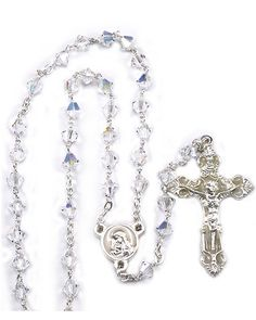 Clear #Swarovski #Crystal multifaceted beads with silver finish links and clasp, enameled #Madonna and Child center and an oxidized enameled #Crucifix. Made in Italy.(sku 4-1521w)