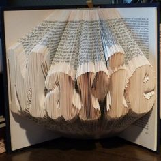 Free pattern to create a folded book with the name Marie. Kirigami, Diy Butterfly, Book Folding Patterns, Folded Book Art, Free Books, Paper Cutting, Decoration, Free Pattern, Art Deco