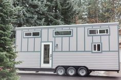 A luxury tiny house available for sale in Spokane, Washington, with a full kitchen, bathroom, living room, and loft bedroom.