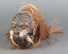 Lot A wax model of a shrunken head est Modern Primitives, Shrunken Head, Tiki Bar Decor, Sculptures, Lion Sculpture, Tiki Tiki, Zombie Art, Tiki Room, Mesoamerican