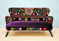 Handmade two seater sofa upholstered with Suzani and purple color velvet fabrics. Beautiful combination of the lovely colors. The wood