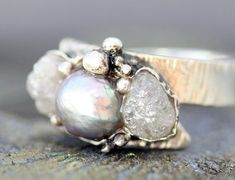 raw diamond & grey pearl ring by Specimental  (who knew rough diamonds were so amazing?)