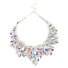 It is time to shine! Literally. With this timeless piece, you will have everyone's eyes on you. This bib necklace features a cluster of rhinestones and iridesc…