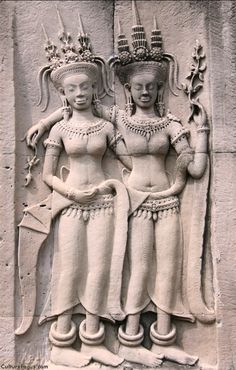 Devatas - guardian spirits or angels - carved in stone at Angkor Wat