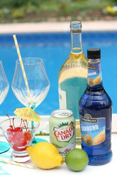 Tropical Blue Sangria- 3 ½ cups white wine, ½ cup blue curacao, 1 cup ginger ale (added just before serving) limes, lemons, and other citrus fruits for garnish