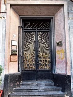 art deco peacock doors