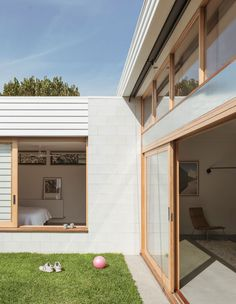'A family home on a compact site, the design respects the existing weatherboard home and produces a north-facing courtyard central to the home. The home is made robust for family life with kids and pets. Australian Architecture, Architecture Design, Weatherboard House, Compact House, The Design Files, House Extensions, Home Reno, House Goals, Exterior Design