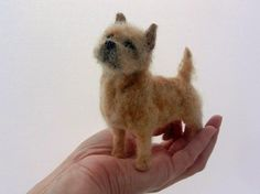 needle felted cairn terrier. Looks so real like a teeny weenie puppy in her hand! Celia