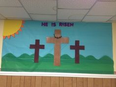 Easter Bulletin Board Sunday School I used table cloth for the sky and grass and made the crown of thorns with pipe cleaners Easter Bulletin Boards, Christian Bulletin Boards, Church Bulletin Boards, Preschool Bulletin Boards, Preschool Door, April Preschool, Bullentin Boards, Preschool Ideas, Toddler Sunday School