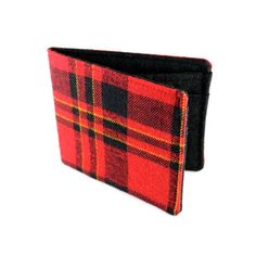Wallets from old suits and shirts. There is a Professor Tweed and a tons of Lumberjack plaids to choose from!