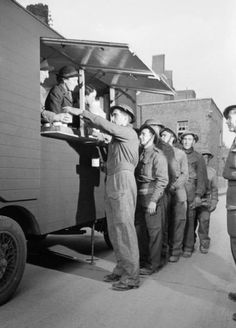 """The Women's Voluntary Service ran a """"mobile canteen"""" to provide food and drinks for those cleaning up rubble after the London Blitz. In true British form, tea was served."""