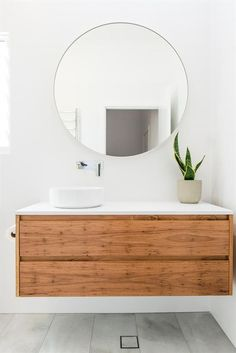 Check out this amazing design idea for my next bathroom remodel! I love the statement wood vanity cabinets complemented by the clean white subway tile walls, large round mirror and wood accents for a nice pop! Next Bathroom, Diy Bathroom Vanity, Bathroom Red, Boho Bathroom, Chic Bathrooms, Simple Bathroom, Bathroom Styling, Bathroom Interior Design, Floating Bathroom Vanities