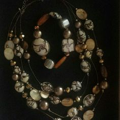 Necklace and bracelet set The beads on this set are so pretty. 4 strand necklace and stretch bracelet Jewelry
