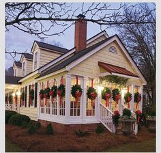 A Christmas wreath hung with red ribbon for every window just looks amazing.