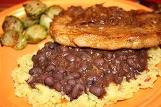 Fleur de Lolly: Cuban Styled Pork Chops with Black Beans over Yellow Rice