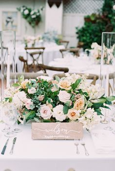 pastel florals and calligraphy wood signs   Photography: Carmen Santorelli