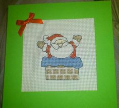 Santa in Chimney Christmas Card on green or red Christmas card   $2.50 each  Trifold card so stitching is covered.  Comes blank ready for your inscription.  Also comes with an envelope.  Facebook - Custom Cross Stitch Creations