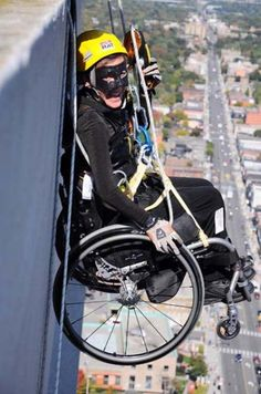 A Masked Superhero in a Wheelchair Descends the Building