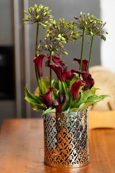 fall wedding flowers|  go thoroughly modern and chic with calla lilies paired with exotic blooms in a large round vase or smaller silver container