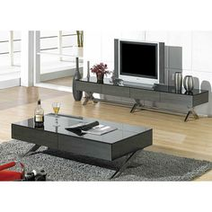 The Torino TV Stand has a sleek, low profile design with chrome x-shaped legs for support and a light and airy feel. This modern entertainment center features a black mirror glass top and your choice of white or gray mirrored glass front, back, and side panels. Four storage drawers offer a place to keep your CDs, DVDs, and gaming consoles out of sight. $649.00