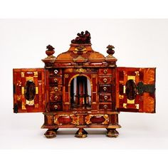 Gdańsk, Poland (possibly, made) Date: early 18th century Artist/Maker: Unknown Amber on a wooden core with a metal lock and hinges; with later plastic and plaster restorations