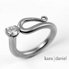 I'm lucky enough to live in the same city as these remarkable artists. Their gorgeous pieces are pure art. diamond ~ stainless scroll ring by kara | daniel, via Flickr