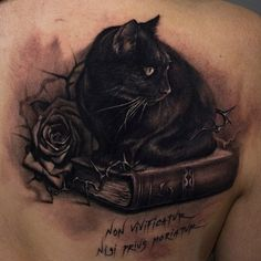 Black cat sitting on a book tattoo - Tattooimages.biz…