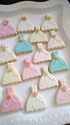 Cute idea - lovely petite gown cookies with a molded fondant flower bouquet accent.