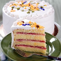 Danish Layer Cake - This is our most popular cake that is unique to Racine and devoured by out-of-towners.  This Danish culinary masterpiece consists of three layers of our homemade raspberry jam and creamy custard between four layers of our moist yellow cake and iced with our super-smooth buttercream.  Each Danish Layer Cake is hand decorated by our expert cake decorators.