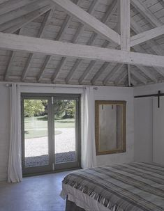 The bedroom at the Cow Shed, a Victorian barn conversion by Nash Baker Architects in Suffolk, showing the vaulted ceiling with exposed lime washed timber roof. Photo by Nick Guttridge Roof Beam, Timber Roof, Roof Trusses, Exposed Trusses, Hip Roof Design, Roof Truss Design, Roof Ceiling, Open Ceiling, Cow Shed
