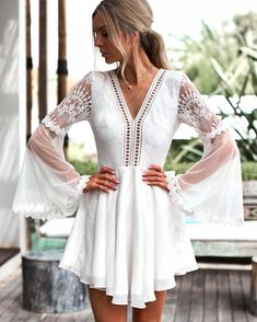 With a cut out back, tassel ties, and a combination of lace textures, this mini dress offers a boho look with a sexy twist. The Feeling Flirty mini dress featur Backless Maxi Dresses, Chiffon Dress, Short Beach Dresses, Short Boho Dress, Formal Boho Dress, White Semi Formal Dress, White Boho Dress, White Lace, White Long Sleeve Dress