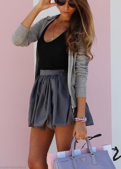 grey zip up over black shirt & a mini Skirt loving the dressy casual clash, it works.