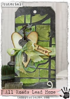 Tammy Tutterow Tutorial   All Roads Lead To Home Tag.  Tutorial shows how to create a tag using a stencil with embossing paste to create a textured effect.